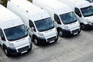 overhead of delivery vans parked in a row