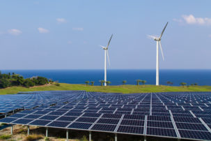 solar panels, wind turbines and scenic background