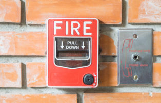 Fire Alarm on a brick wall