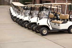 Photo of golf carts parked next to each other